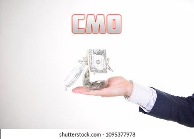 A businessman with a bank of money shows an inscription:CMO