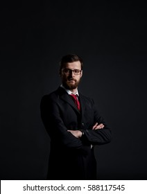 Businessman with beard. Black background with copyspace. Business and office concept.