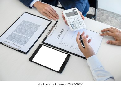 Businessman being analysis and making the decision a car insurance policy, Agent man is holding the calculator and waiting for his reply to finish.