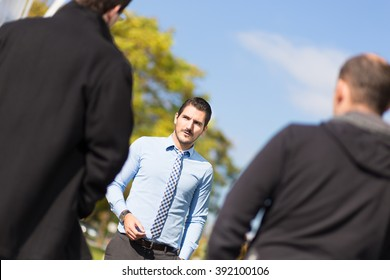 Businessman being approached and blackmailed by two racketeers.