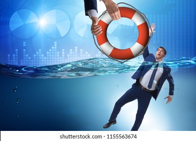 Businessman being saved from drowning