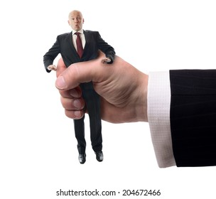 Businessman being squashed in a hand isolated on a white background, concept of problems at work.