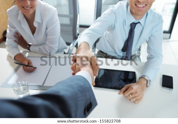 Businessman being welcomed into the company by his new colleagues