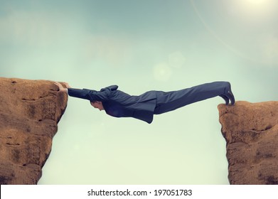 businessman between a rock and a hard space