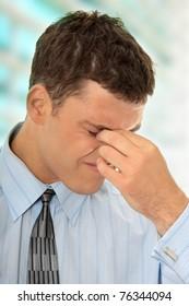Businessman with a big headache