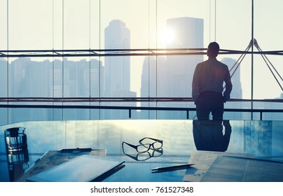 Businessman in a big office