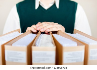 Businessman with binders at office.