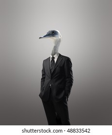 Businessman with a bird's head instead of his human head