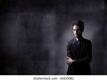 businessman in black with black background