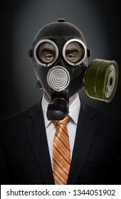 businessman in black costume and gas mask; concept adioactive or chemical pollution
