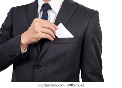 Businessman in black costume suite put or take out credit card in pocket.