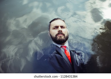 Businessman in a black jacket and a red tie. Swimming on the back of the pool