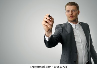 businessman with black marker in the hand