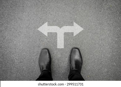 Businessman in black shoes making decision at the cross road
