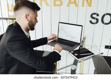 The businessman in a black suit analyzes currencies and ciphers currencies, The businessman in a black suit analyzes currencies and cryptocurrency bitcoi, ethereum, btc, eth