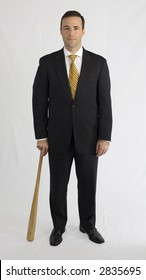 Businessman in black suit with baseball bat
