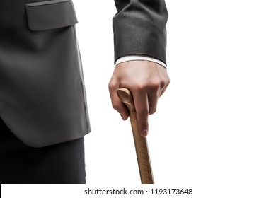 Businessman in black suit hand holding wooden walking cane stick white isolated