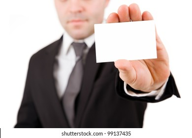 Businessman in black suit offering card, isolated over white background