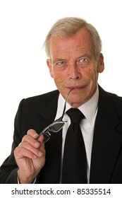 Businessman in black suit over a white background