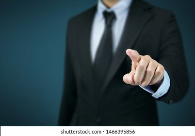 Businessman in black suit is pointing his finger to touch the screen concept