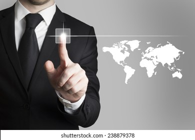 businessman in black suit pushing button worldmap global communication