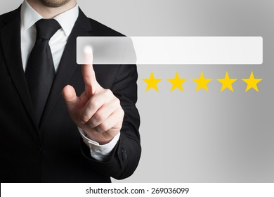 businessman in black suit pushing flat button five rating stars