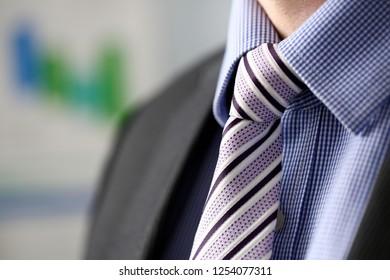 Businessman in black suit set tie closeup. White collar management job serious move secretary student luxury formal interview executive agent marriage store corporate elegance employment preparation