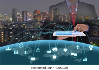 businessman in black suite using tablet control the world , internet of things concept