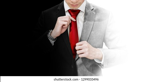 Businessman in blank and white suit tying red necktie. Good and devil, true identity, and balance concept