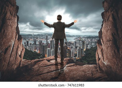 businessman blessing city from a stone cave gate