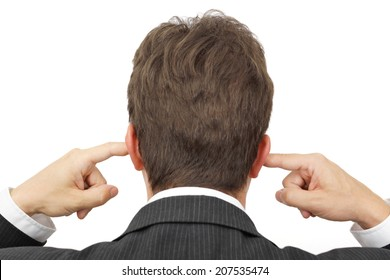 businessman blocking his ears with fingers .  deaf manager concept
