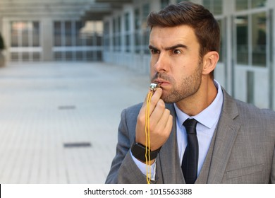 Businessman blowing a whistle isolated