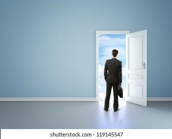 businessman in blue room with door in sky