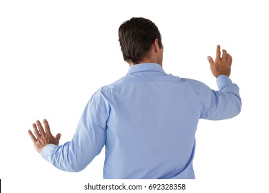 Businessman in blue shirt using interface against white background