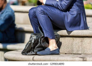 businessman in blue suit outdoors in summer no socks