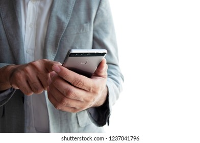 Businessman in blue suit using his Mobile Phone on isolate background.