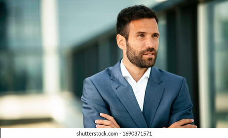 Businessman in a blue suit. Young handsome man outdoors.