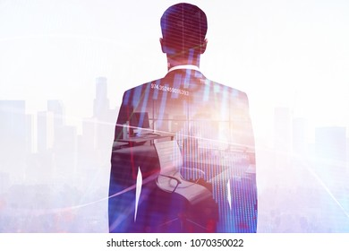 Businessman in blurry office interior with forex chart. Worker, broker and trade concept. Double exposure