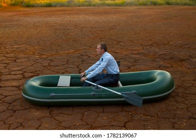 businessman in boat rocks looks bright future symbol crisis stagnation losses braking difficulties environmental disaster water scarcity drought man will rows home for shore in paddle powered row