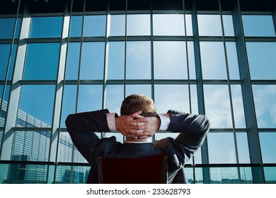 businessman boss of the company relaxing and looking at the window