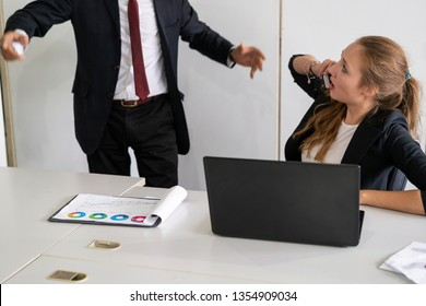 Businessman boss feels angry and mad at bad misbehaving businesswoman employee who ignores the work tasks at the workplace. Firing workers and human resources management problem concept.