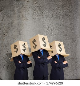 Businessman with box on head and dollar sign