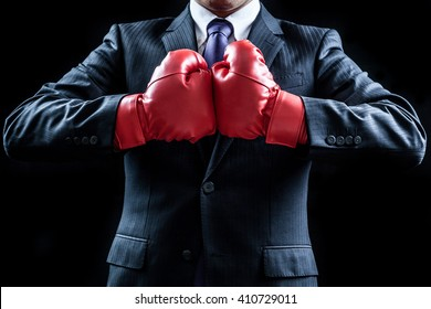 Businessman , boxing gloves , fighting pose