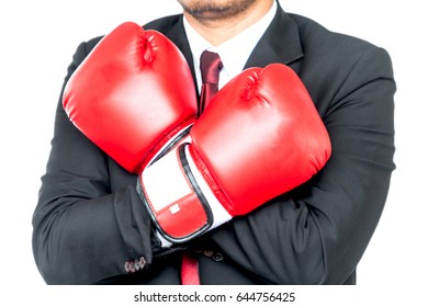 Businessman and boxing gloves isolated on white background