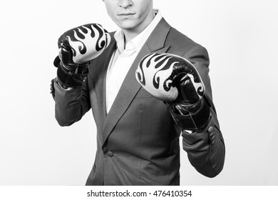 businessman in a  boxing gloves isolated ready to fight