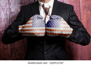 Businessman in boxing gloves with USA flag