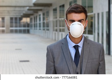 Businessman with a breathing mask isolated in office space
