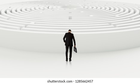 Businessman with briefcase choosing between entrances in maze