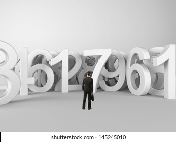 businessman with briefcase looking at figures symbols