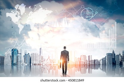 Businessman with briefcase looking at global business charts and graphs on New York city background with sunlight